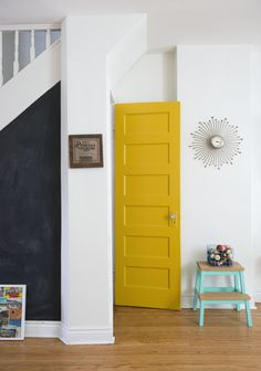 The yellow door paint job cost me $1.50 (as I type with thrifty pride). I picked up one of those mis-tinted cans of paint at RONA years ago for no particular reason but knew I couldn't pass it up. When we moved in I decided to use it to add a nice vibrant splash of colour to the room by painting the door that leads to the basement. You may have seen this post I did a while back showing off my Instagram photos under our staircase. I found that got old pretty fast and decided to paint it…
