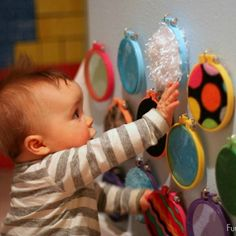 20 Amazing Baby DIY Activites (Pictured is a diy sensory wall).