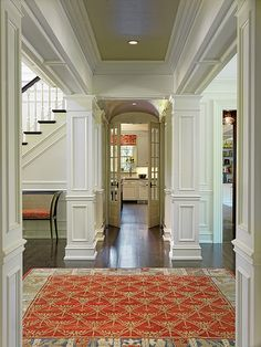 Beautiful example of the use of Crown Molding, baseboards, panel moldiing, casings, etc...throughout this amazing space.    Sandford-Custom-Hall-BD15 by Boston Design Guide