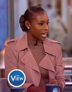 Issa Rae. Low parted side bun with flat twists.