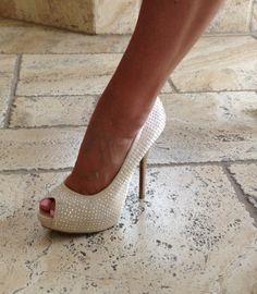 Jennifer Lopez bling white high heel.