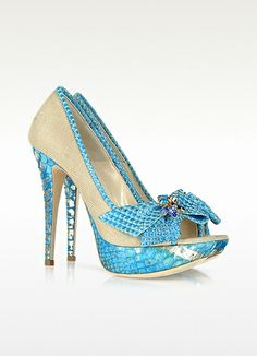 LORIBLU Python Leather and Canvas Pump. Turquoise python leather adds an exotic urban twist to this beige canvas pump with peep toes, covered stilettos and a bright bow. Signature dust bag included. Made in Italy. http://www.eu.forzieri.com/shoes/loriblu/lr431112-005-01