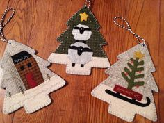 "Auntie Ju's Quilt Shoppe - Three Woodland Ornaments kit, $25.99 Kit contains wool and pattern to complete three woodland ornaments - Finished sizes approx. 5.5"" x 6.5""(http://stores.auntiejusquiltshoppe.com/three-woodland-ornaments-kit/)"