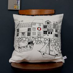 printed cushion seaside houses by poppy treffry   notonthehighstreet.com
