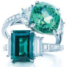 Tiffany & Co diamond and gemstone rings in platinum, set with a cushion-cut green cuprian elbaite tourmaline, above, and emerald-cut alexandrite, below. Via The Jewellery Editor.