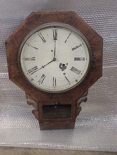 An 8 day Time Pc. made by Waterbury. The case is Rosewood with walnut trim. Overall 24 tall & 17 wide. Having a 12 dial. Has pendulum & key. The movement is complete & good mainspring. It would run