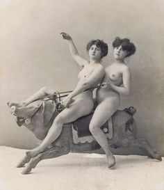 Two women on a carousel Pig c. 1900.