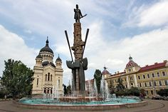 Dormition of the Theotokos Orthodox Cathedral and Avram Iancu Statue in Cluj-Napoca, Romania Globe Travel, I Want To Travel, Travel Articles, Cathedrals, Passport, Statue Of Liberty, Travel Photography, Beautiful Places, Places To Visit