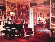 Beautiful ebony grand piano in her New York apartment...and, look at ALL those books ~ Jackie Kennedy