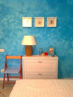 Faux Painting 101: Tips, Tricks, and Inspiring Ideas for Faux Finishes turquoise blue faux painted wall finish