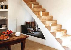 It would be awesome to create a sitting area under the stairs adjacent to the pool table.
