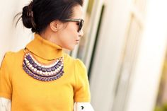 Wendy Nguyen of Wendy's Lookbook Pairing A Bright Chunky Knit Sweater & Our Indira Statement Necklace