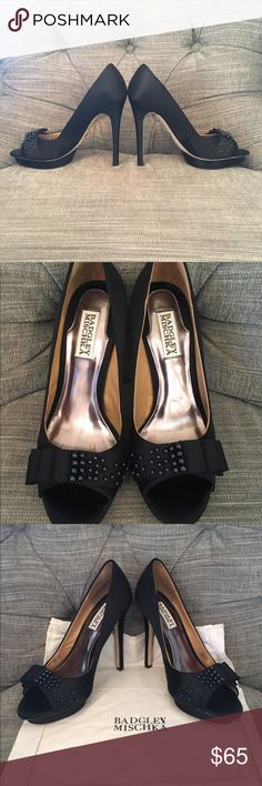 "Badgley Mischka Black Owen Heels The Owen pump from Badgley Mischka stands out with an elegant evening platform and beading details. Satin upper Round toe with grosgrain bow and beading Dust bag included ½"" island platform, 4½"" covered heel Leather sole Badgley Mischka Shoes Heels"