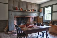 cooking hearth | cooking hearth with cupboards above mantle...