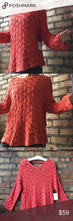 NWT Free People Open Back Coral Reef loose knit Loose knit, open back, flared sleeves. So comfy. New with tags Free People Sweaters