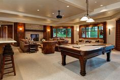 Traditional Game Room with Pendant Light, Carpet, Exposed beam, High ceiling