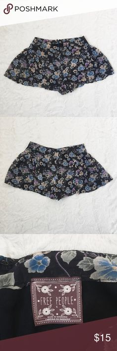 Free People Floral Shorts Size 4 Floral shorts. A few strings have been pulled as seen in the last picture Free People Shorts