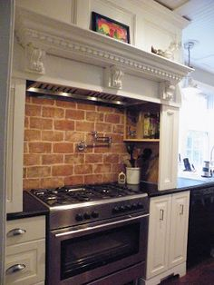 Circa 1840 Working Farmhouse. this is the traditional treatment for the oven in a nauvoo-era home.  brick backsplash with a wrap-around wood hood.  this would look amazing in your home.  i would recommend this over a copper hood.