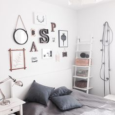Ikea 'Hjälmaren' shelf in feminine bedroom
