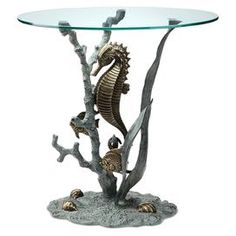 "Verdigris and bronze-finished aluminum table with an undersea design and a glass top.   Product: Side tableConstruction Material: Aluminum and glassColor: Verdigris and bronzeDimensions: 22"" H x 22"" Diameter"