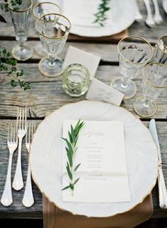 Gold Rimmed Champagne Saucers, olive branches on the menu, rustic wood table