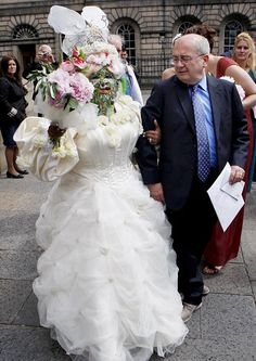 Over 6,000 piercings! What the hell! The pierced bride and her groom.