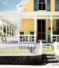 Theres just something a pretty yellow house and of course the wrap around verandah. Lovely.