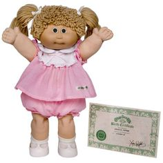 """Cabbage Patch Kids... mine was a girl with red hair in pigtail braids... and the name she came with was a doozy: """"Fanny Bliss"""" ... haha!"""