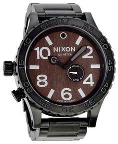 Nixon 51-30 Dark Wood Mens Watch A0571107 NIXON. $356.00. Quartz. Round Ion Plated Stainless Steel Case. Water Resistance : 10 ATM / 100 meters / 330 feet. Analog Display. Black Steel Bracelet Strap