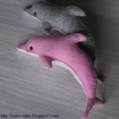 Felt Dolphin toy pattern, nice and simple, perhaps add bells, lavender or a rattle inside?  @scottibe this is a little like the cat rattle you made.  The site also has an amazing giraffe and zebra plushie pattern.