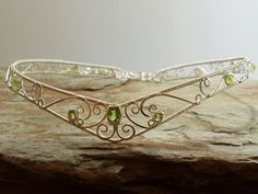 Celtic Circlet - Peridot wedding collect  I am going to make something like this with 16 to 24 gauge sterling in each of the sizes. The wire wrapping in 24 the intricate in 20 the bolder in 18 the frame in 16