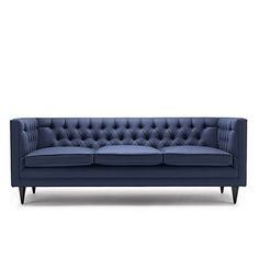 TUX LUX SOFA BY STUART SCOTT. Shown here upholstered in Holland & Sherry navy wool felt, with legs in black lacquered walnut. Built to order by hand in England. Hand signed and individually numbered. stuartscott.co.uk