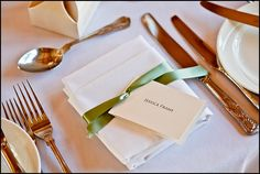 Name tags tied with ribbon around napkin.  Very simple and elegant.