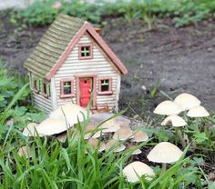 Little clay house  by Harry Tanner illuminated ceramic sculpture or garden art