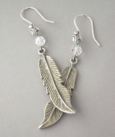 Antiqued silver feather earrings dramatic metal by Mindielee, $18.00