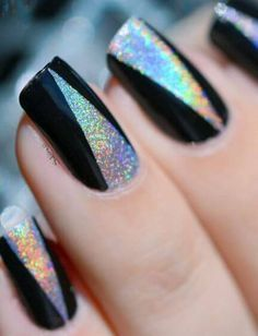 black nail polish with glittery metallic silver triangles in the center of each nail
