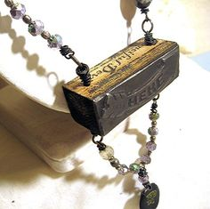 Found Object Necklace. @Renee Nulf I might be able to make this out of your stamps!