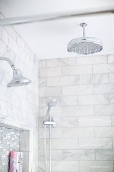 Bathroom Makeover Bathroom makeover via I Heart Naptime: Grey and white bathroom remodel with Carrara marble herringbone tile tile, white vintage tub and blue accents. Carrara Marble Bathroom, Marble Tile Shower, Marble Bathtub, Marble Tiles, Marble Herringbone Tile, Vintage Tub, Marble Showers, Master Shower, Bathroom Flooring