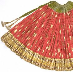 Gota Work    Gota Work involves the application of gold and silver ribbon edging.    Gaghra (skirt), detail  Silk with gold ribbon (gota) appliqué  Punjab/Rajasthan borders  Mid 19th century