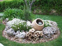 steingarten gestaltungsideen kies pflanzgefaess rund deko