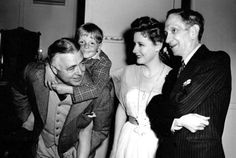 Little Jackie 'Butch' Jenkins and his grandfather, author Bide Dudley, visit director Clarence Brown and Irene Dunne on the set of The White Cliffs of Dover