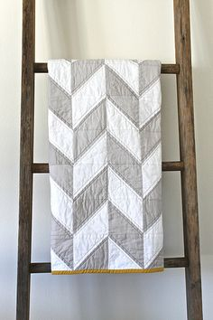 Very cool grey and white herringbone quilt. And I love the quilting. It hides the half square triangles