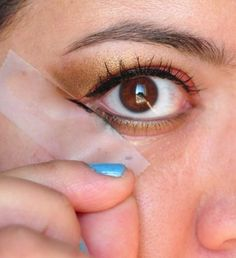 Use Scotch tape to keep eye shadows and liner even for both eyes... Click the link for more tips!