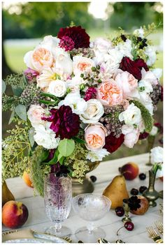 Beautiful wedding floral centerpiece in a pretty palette of red and pink by Southern Posies, image by Penni Lauren Photography.