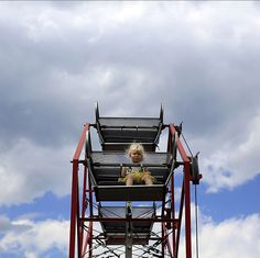 A lone rider on the #ferriswheel at Huck Finn's Playland, an amusement park in #Albany that recently went for a bit of a ride. When the park's original owners retired, two local businessmen moved it six miles from a booming suburb to a rarely visited part of the city. @nathaniel_brooks_photo visited the park — formerly known as Hoffman's Playland — in its new home, next to a furniture store in a district of warehouses, some open and others derelict.   https://instagram.com/p/4X2hCJL21s/?taken-by