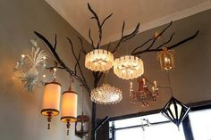 An iron tree ($12,000) displays a mix of light fixtures ($800 to $5,000 apiece) from the 1920s to the 1960s.