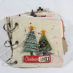 "Hello Roadies, Mandy here and I can't wait to share my canvas Christmas mini album with you! I've had this canvas albm stashed away in my drawer for ""just the right project"" and a stack of *ahem* last year's. Christmas Mini Albums, Christmas Journal, Christmas Scrapbook, Christmas Minis, Christmas Paper, Christmas Projects, All Things Christmas, Holiday Crafts, Christmas Canvas"
