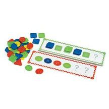"""ExcellerationsWho's Got the Button? Patterning Activities. Do you see a pattern? Young ones will love this fun patterning game. Players match buttons to corresponding designs on laminated, double-sided pattern cards. Helps build early math skills. Set includes 16 illustrated, full color cards, 15""""L x 4""""W, and 48 assorted buttons in vibrant colors, 2 1/2""""D. Ages 3 years and up."""