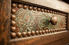 2014 western decorating is all about personalizing. Update drawers with leather and brass studs. More