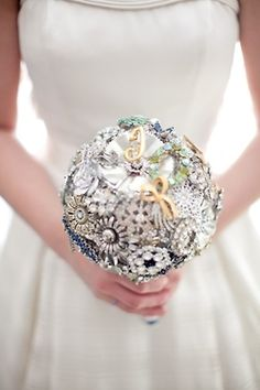 Pins/brooch bouqet - don't love these exact brooches but love the idea of having something that you can save forever!